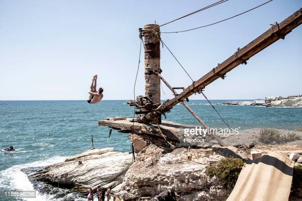 In this handout image provided by Red Bull Andy Jones of the USA dives from a 10 metre crane platform in Raouche during the final competition day of...