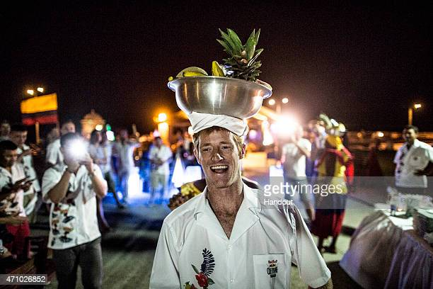 In this handout image provided by Red Bull Andy Jones of the USA carries a bowl of fruit on his head during the luckydraw competition to determine...