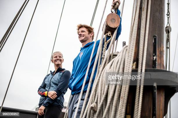 In this handout image provided by Red Bull Andy Jones of the USA and Rhiannan Iffland of Australia onboard the caravel Vera Cruz while sailing on the...