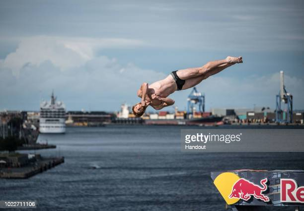 In this handout image provided by Red Bull Andy Jones of the USA dives from the 27 metre platform on the roof of the Opera House during the first...