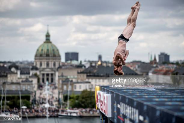 In this handout image provided by Red Bull Andy Jones of the USA dives from the 27 metre platform on the roof of the Opera House during the final...