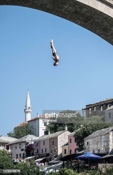 In this handout image provided by Red Bull Andy Jones of the USA dives from the 27 metre platform on Stari Most bridge during the first competition...