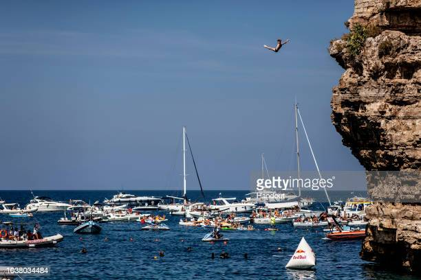 In this handout image provided by Red Bull Andy Jones of the USA dives from the 27 metre platform during the first competition day of the seventh and...