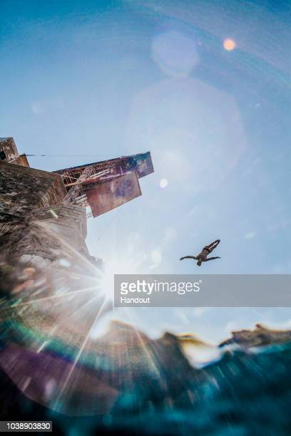 In this handout image provided by Red Bull Andy Jones of the USA dives from the 27 metre platform during the last competition day of the seventh and...