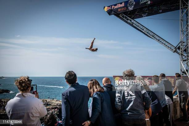 In this handout image provided by Red Bull Andy Jones of the USA dives from the 27 metre platform during the first competition day of the third stop...