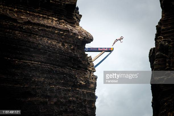 In this handout image provided by Red Bull Andy Jones of the USA dives from the 27 metre platform at Islet Vila Franca do Campo during the final...