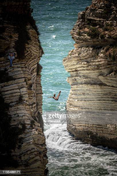 In this handout image provided by Red Bull Andy Jones of the USA dives from the 25 metre cliff in Raouche during the first competition day of the...