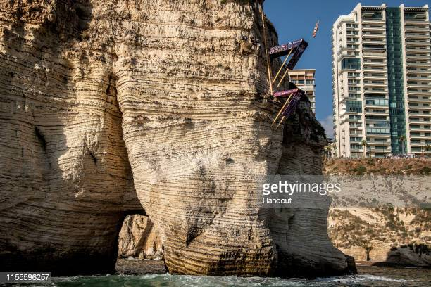 In this handout image provided by Red Bull Andy Jones of the USA dives from the 27 metre platform in Raouche during the final competition day of the...