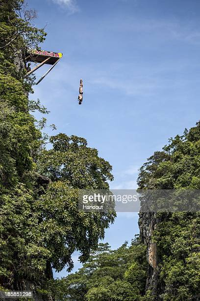In this handout image provided by Red Bull Andy Jones of the USA dives from the 27 metre platform at training on Hong Island in the Andaman Sea...