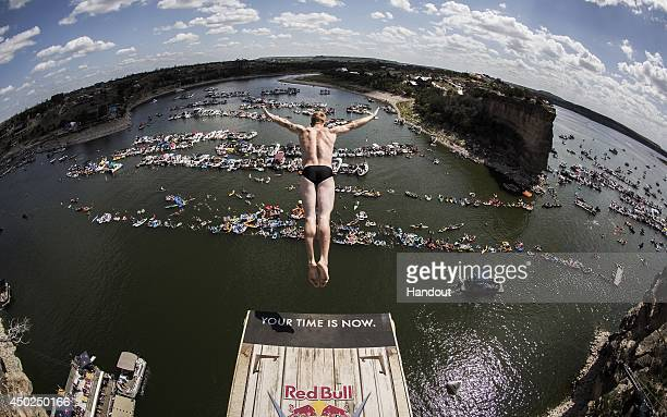 In this handout image provided by Red Bull Andy Jones of the USA dives from the 28 metre platform at Hells Gate during the second stop of the Red...