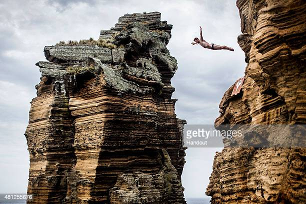 In this handout image provided by Red Bull Andy Jones of the USA dives from the 27 metre cliff face during the fifth stop of the Red Bull Cliff...