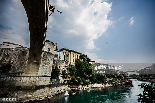 In this handout image provided by Red Bull Andy Jones of the USA dives from the 28 metre platform on the Stari Most bridge during the seeding round...