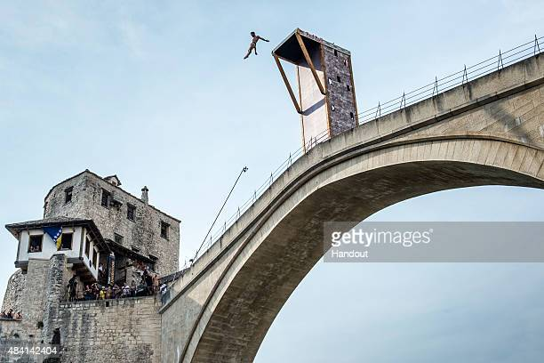 In this handout image provided by Red Bull Andy Jones of the USA dives from the 28 metre platform on the Stari Most bridge during the sixth stop of...