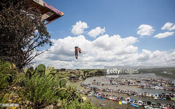 In this handout image provided by Red Bull Andy Jones of the USA dives from the 275 metre platform on Devil's Island during the first stop of the Red...