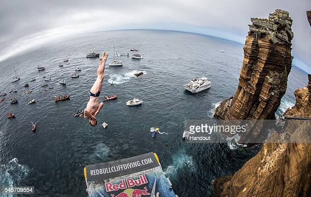 In this handout image provided by Red Bull Andy Jones of the USA dives from the 27 metre platform at Islet Franca do Campo during the third stop of...