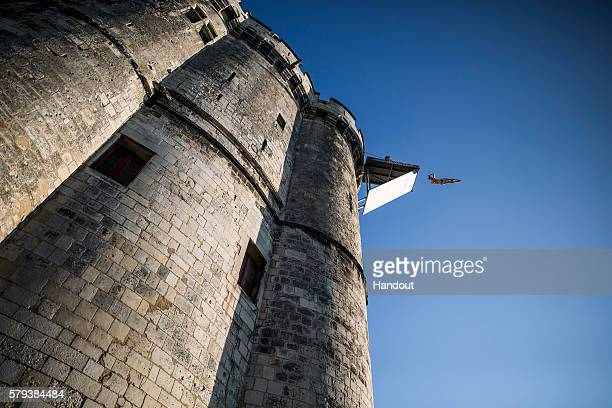 In this handout image provided by Red Bull Andy Jones of the USA dives from the 27 metre platform on the Saint Nicolas Tower during the fourth stop...
