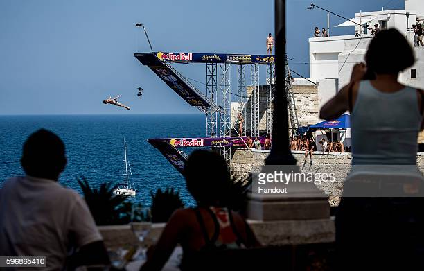 In this handout image provided by Red Bull Andy Jones of the USA dives from the 27 metre platform during the first competition day of the fifth stop...