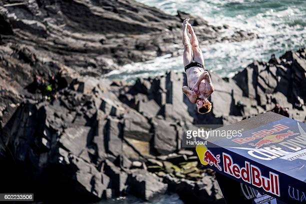 In this handout image provided by Red Bull Andy Jones of the USA dives from the 275 metre platform at the Blue Lagoon during the sixth stop of the...