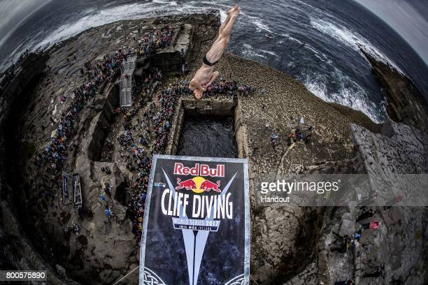 In this handout image provided by Red Bull Andy Jones of the USA dives from the 275 metre platform at the Serpent`s Lair during the first stop of the...