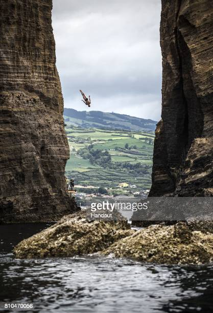 In this handout image provided by Red Bull Andy Jones of the USA dives from the 27 metre platform on Islet Franca do Campo during the first training...