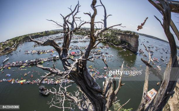 In this handout image provided by Red Bull Andy Jones of the USA dives from the 27 metre platform during the fourth stop of the Red Bull Cliff Diving...