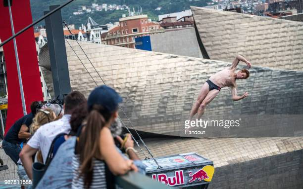 In this handout image provided by Red Bull Andy Jones of the USA dives from the 27 metre platform during the first competition day of the second stop...