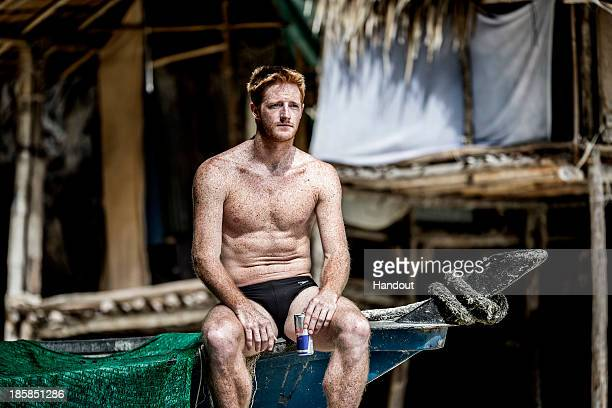 In this handout image provided by Red Bull Andy Jones of the USA sits on a fishing boat before training on Hong Island in the Andaman Sea during the...