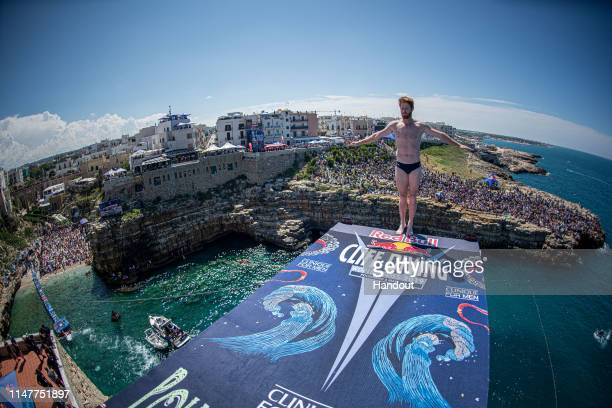 In this handout image provided by Red Bull Andy Jones of the USA prepares to dive from the 27 metre platform during the final competition day of the...