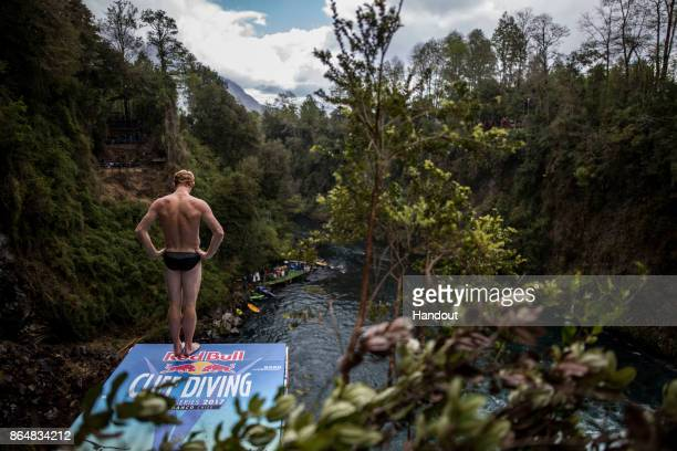 In this handout image provided by Red Bull Andy Jones of the USA prepares to dive from the 27 metre platform during the first competition day of the...