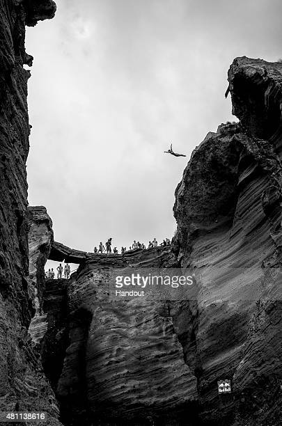 In this handout image provided by Red Bull Anna Bader of Germany dives from a 20 metre cliff during the first training session prior to the fifth...