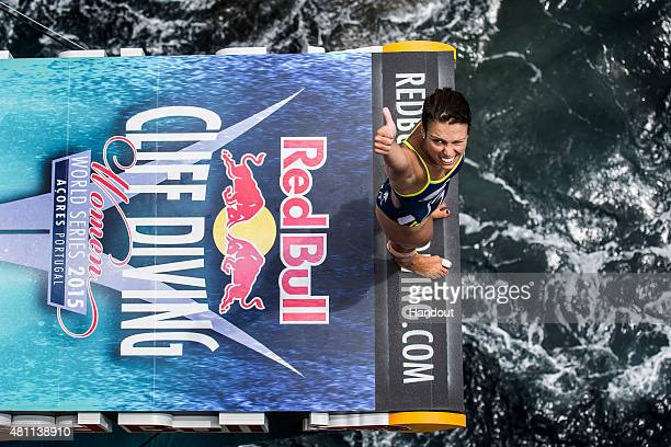 In this handout image provided by Red Bull Anna Bader of Germany gives a thumbs up before diving from the 20 metre platform during the first training...