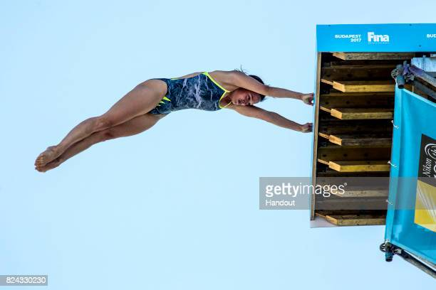In this handout image provided by Red Bull Anna Bader of Germany launches an armstand dive from the 20 metre platform during the final rounds of...