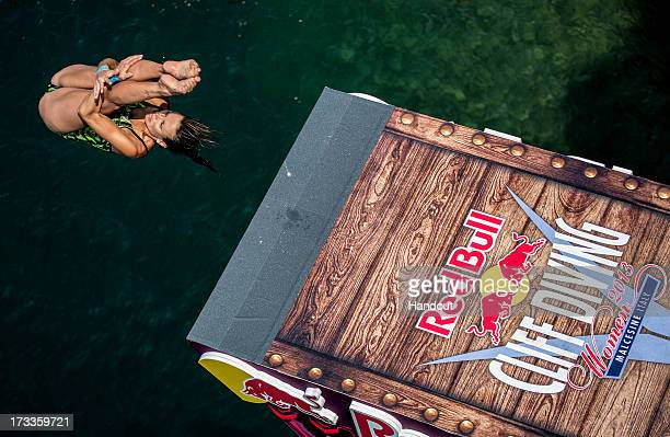 In this handout image provided by Red Bull Anna Bader of Germany dives from the 20 metre women's platform at the Scaliger Castle during the first...