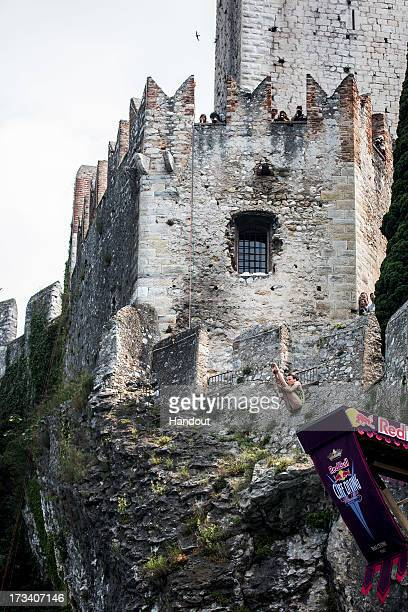 In this handout image provided by Red Bull Anna Bader of Germany dives from the 20 metre platform at Scaliger Castle during the first Red Bull Cliff...