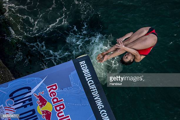 In this handout image provided by Red Bull Anna Bader of Germany dives from the 20 metre platform during the first rounds of the fourth stop of the...