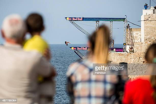 In this handout image provided by Red Bull Anna Bader of Germany dives from the 22 metre platform during the first training session of the seventh...
