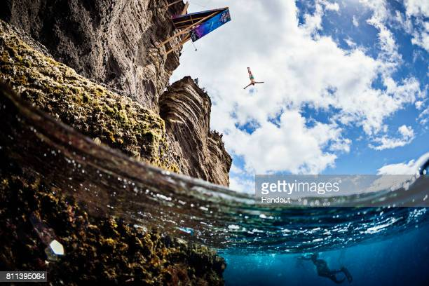 In this handout image provided by Red Bull Anna Bader of Germany dives from the 21 metre platform on Islet Franca do Campo during the second stop of...