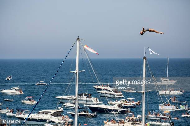 In this handout image provided by Red Bull Anna Bader of Germany dives from the 21 platform during the third stop of the Red Bull Cliff Diving World...