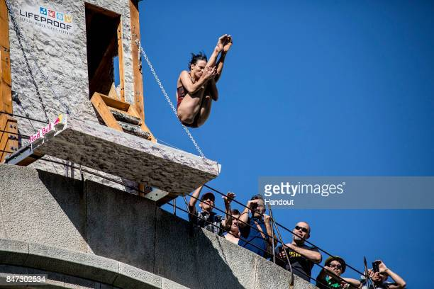 In this handout image provided by Red Bull Anna Bader of Germany dives from the 21 metre platform during the first training session of the fifth stop...