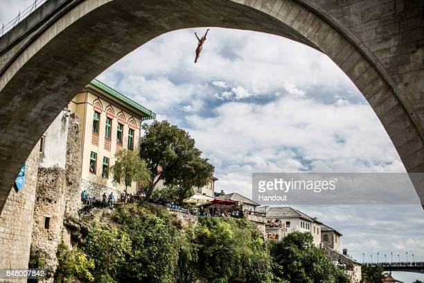 In this handout image provided by Red Bull Anna Bader of Germany dives from the 21 metre platform on Stari Most during the fifth stop of the Red Bull...