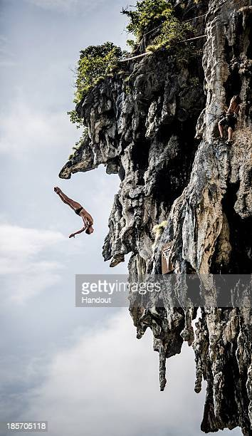 In this handout image provided by Red Bull Artem Silchenko of Russia dives from a 25 metre rock at Viking Caves in the Andaman Sea during competition...