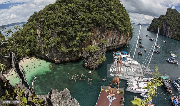 In this handout image provided by Red Bull Artem Silchenko of Russia prepares to launch an armstand dive from the 27 metre platform on Hong Island in...