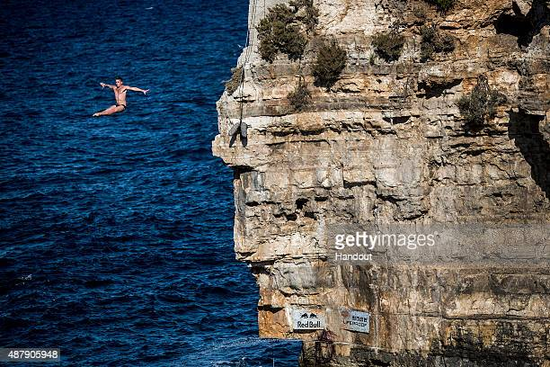 In this handout image provided by Red Bull Artem Silchenko of Russia dives from the 275 metre platform during the seeding round of the seventh stop...