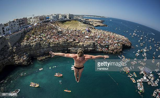 In this handout image provided by Red Bull Artem Silchenko of Russia dives from the 27 metre platform during the fifth stop of the Red Bull Cliff...