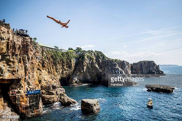 In this handout image provided by Red Bull Artem Silchenko of Russia dives from the 28 metre platform during the first competition day of the eighth...