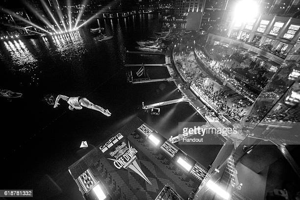 In this handout image provided by Red Bull Artem Silchenko of Russia dives from the 27 metre platform on the Dubai Marina Pier 7 building during the...