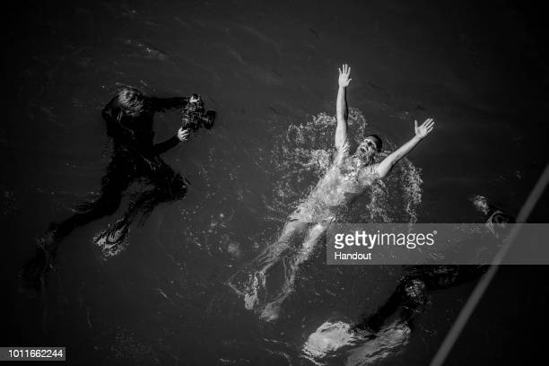 In this handout image provided by Red Bull Blake Aldridge of the UK reacts after his final dive from the 27 metre platform during the final...