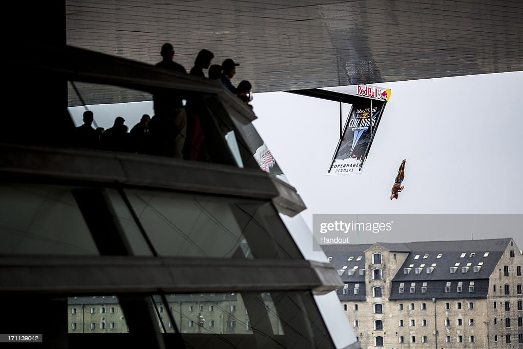 In this handout image provided by Red Bull, Blake Aldridge of the UK dives from the 28 metre platform at the Copenhagen Opera House during the second stop of the Red Bull Cliff Diving World Series on June 22, 2013 at Copenhagen, Denmark.