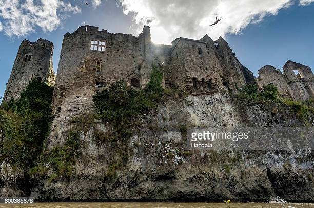 In this handout image provided by Red Bull Blake Aldridge of the UK dives from 26 metres at Chepstow Castle while enroute to Pembrokeshire for the...