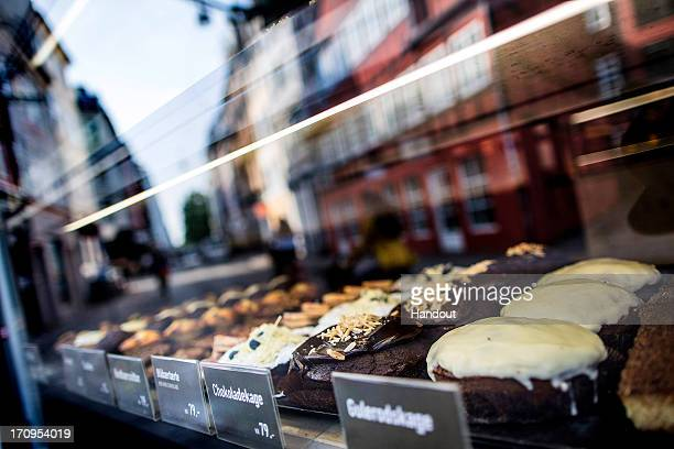 In this handout image provided by Red Bull cakes are displayed in a bakery window during the second stop of the Red Bull Cliff Diving World Series on...
